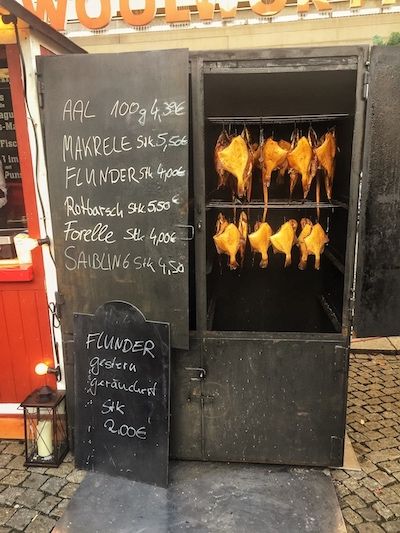 fish being smoked in the traditional method in germany