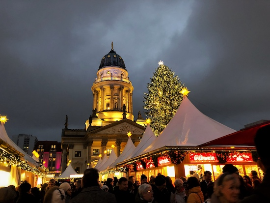 bustling christmas market at gendarmenmarkt in the heart of berlin