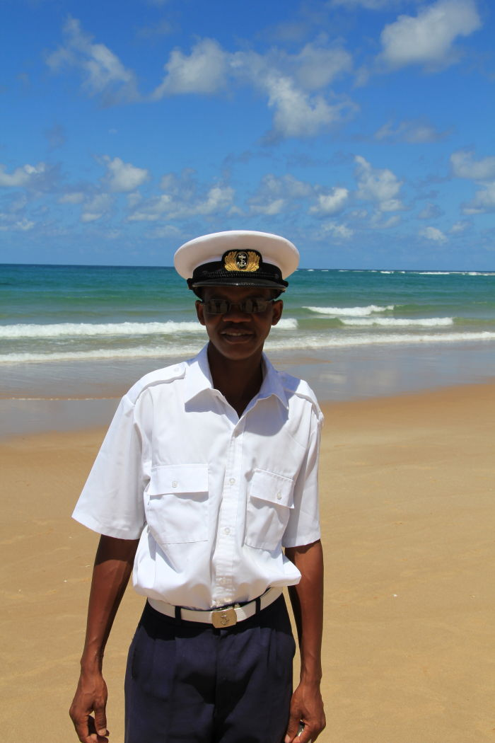 Mozambican traffic police officer posing for the camera along a beach in Mozambique