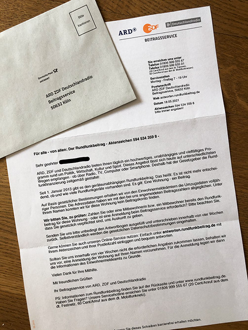 a rundfunkbeitrag letter with an envelope for paying tv tax in germany
