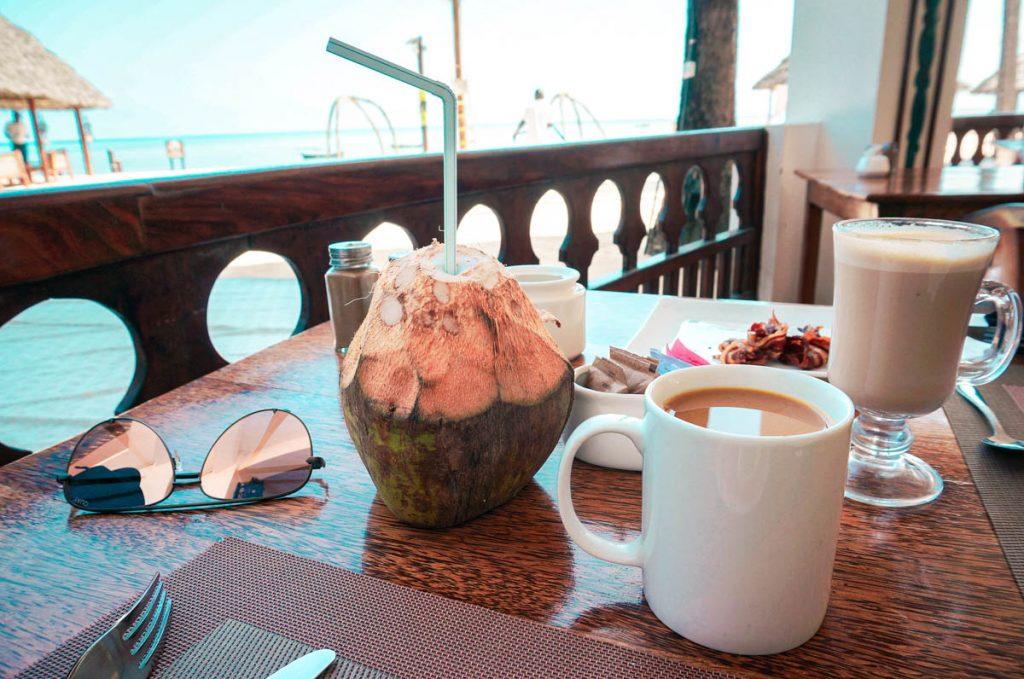 breakfast at a popular zanzibar hotel with a fresh coconut and coffee