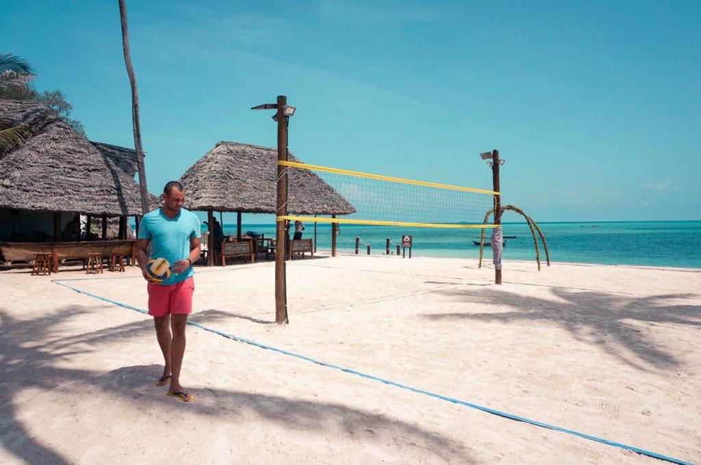 a man holding playing beach volleyball in nungwi zanzibar tanzania