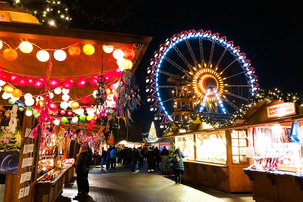 german christmas markets in berlin with ferris wheel and lights in 2020