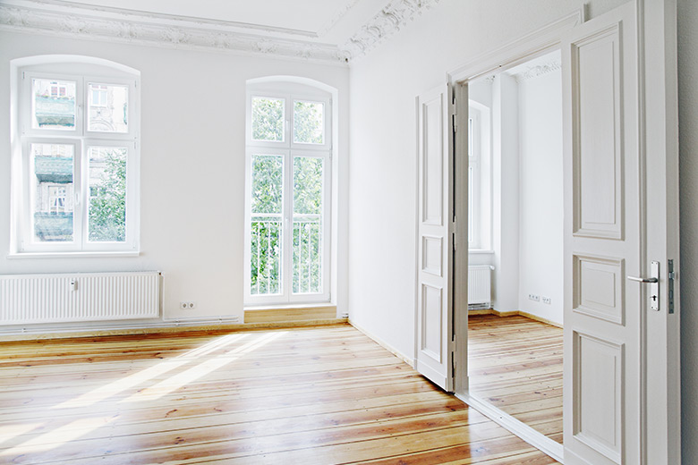 unfurnished flat or apartment in berlin germany with white walls and wooden floors