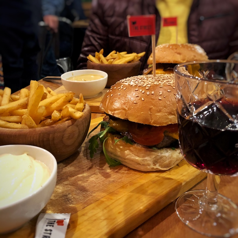 best burgers in prague with chips, sauce and an alcoholic drink