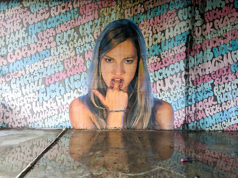 graffit and street art of a girl looking rebellious in berlin