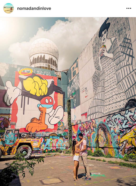 street photography of a couple at teufelbergs spy tower surrounded by colorful graffiti and street art