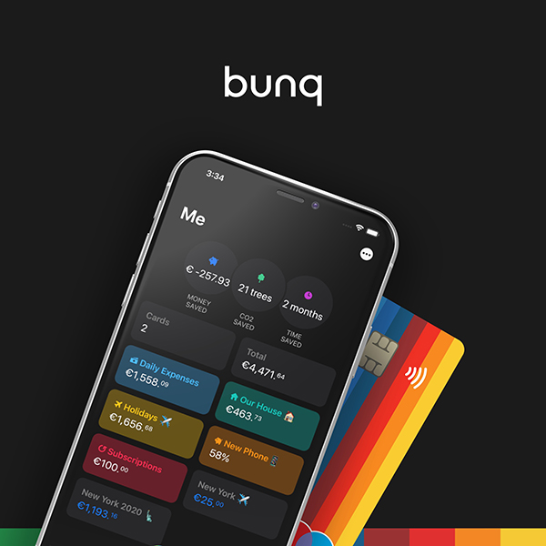 a mobile device displaying the bunq mobile banking app placed in front of a partially shown iconic rainbow bunq bank card