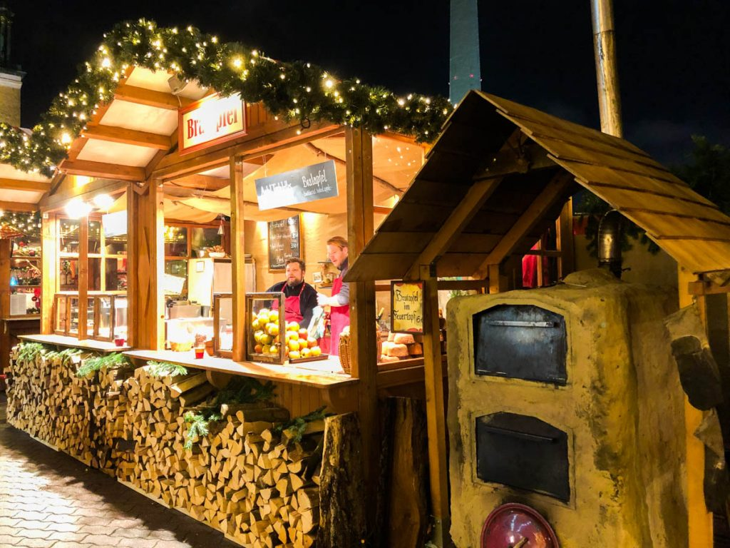a christmas market stall selling traditional german christmas food in berlin germany