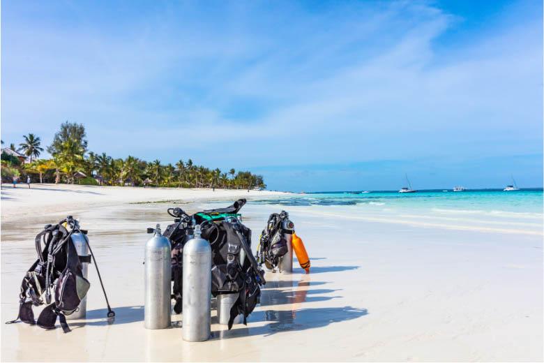scuba diving gear standing in the sand on the beaches of zanzibar island
