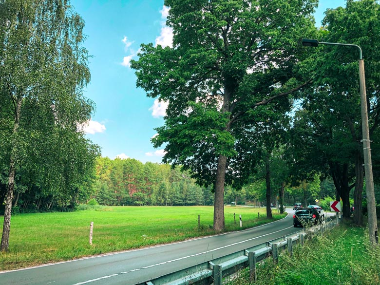 cars driving on the A13 highway in the countryside outside Berlin