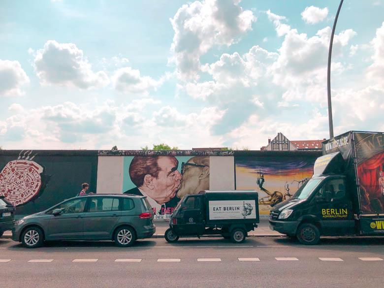 famous berlin kissing graffiti at east side gallery in Friedrichshain-Kreuzberg neighborhood in Berlin
