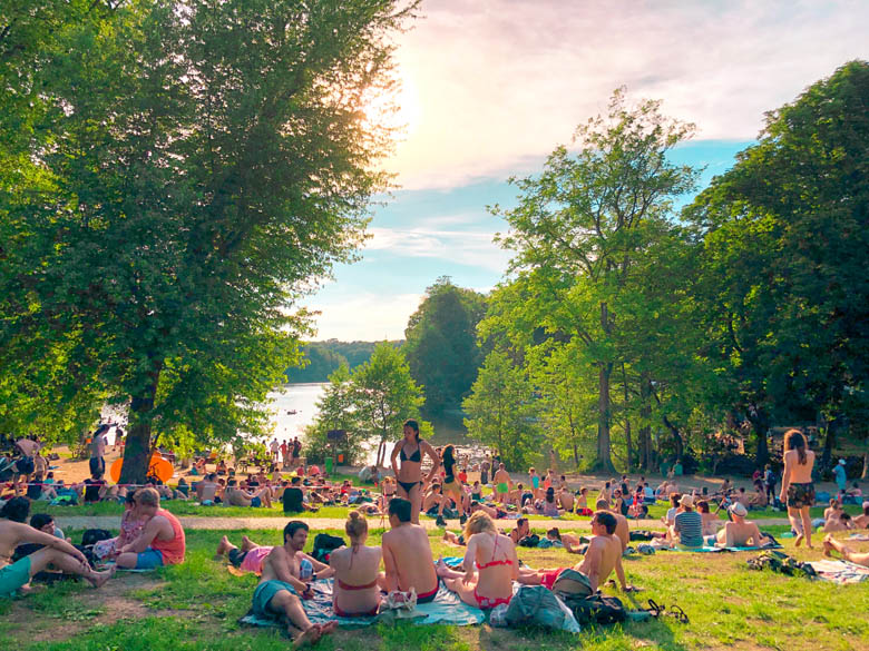 schlachtensee lake is the most popular in berlin and one of the best outdoor things to do with many people sitting on the grass during summer