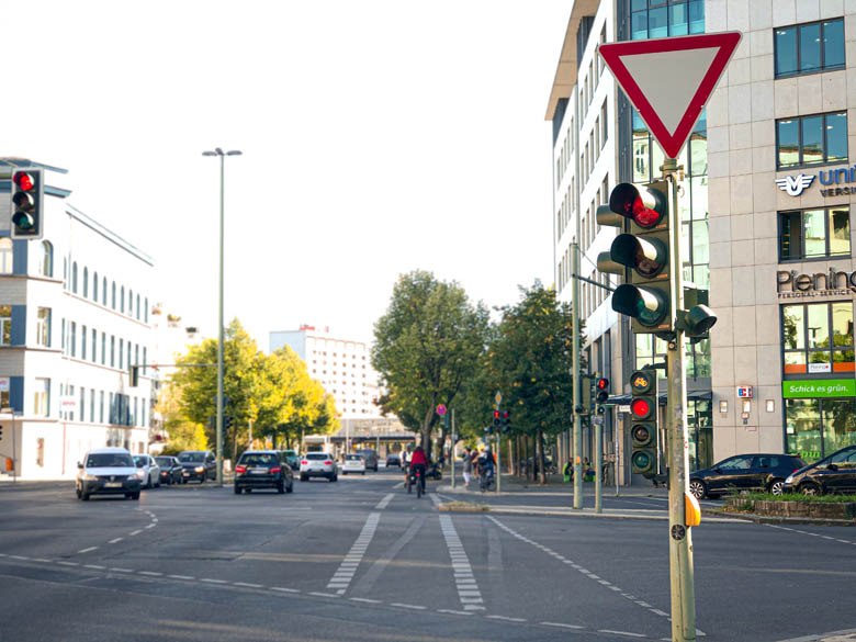 red inverted triangle road sign in germany with dedicated traffic lights for the bike lane