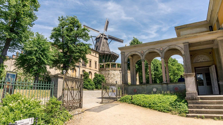 historic mill of sanssouci is a traditional dutch windmill used to grind corn next to sanssouci palace