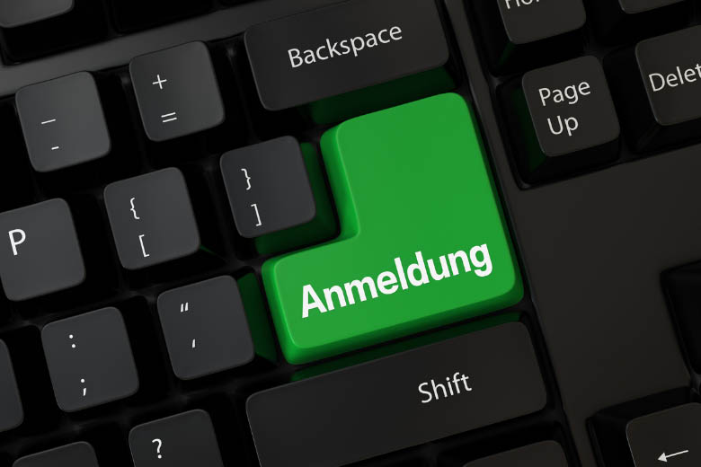 a black keyboard with large green anmeldung button and how to register your new address in Germany