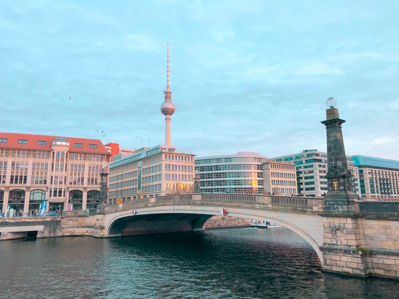 buildings across the bridge in Berlin from Museum Island and a view of apartments, offices and the Berlin Fernsehturm in the background