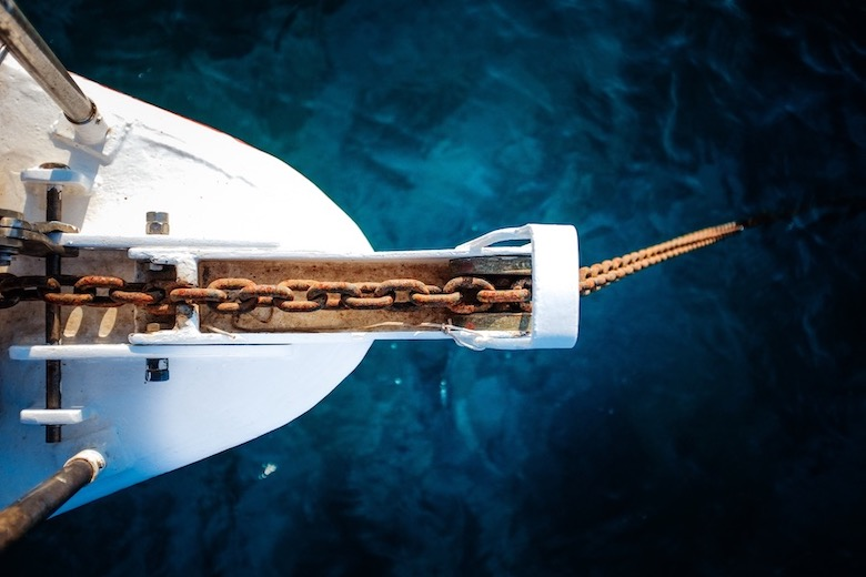 aerial view bow of scuba liveaboard anchored at sea