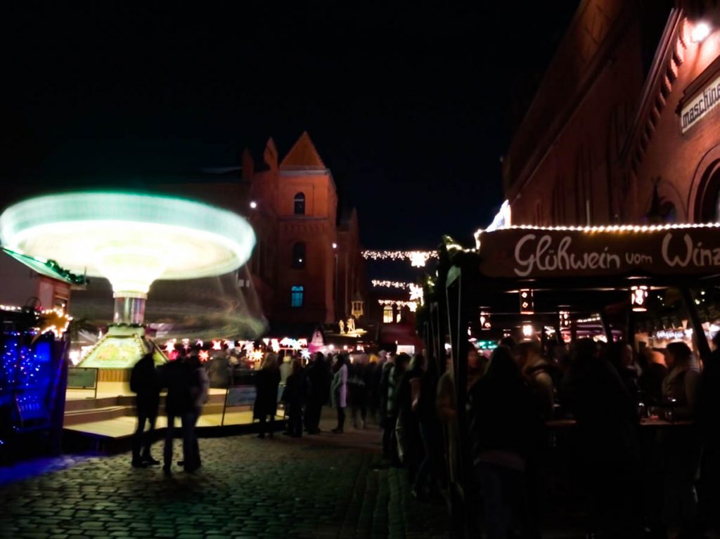 german christmas market in berlin kulturbrauerei with colourful and bright carousel