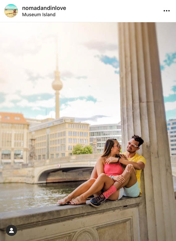 an instagrammable spot in berlin is on museum island along the stone columns with a view of the berlin tv tower in the background