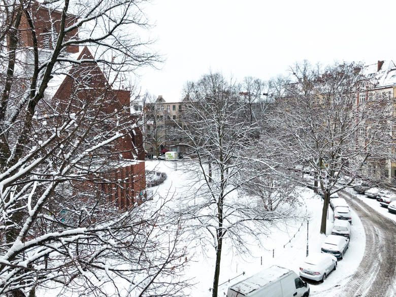 schillierkiez neighborhood in neukolln berlin with lots of snow on the ground