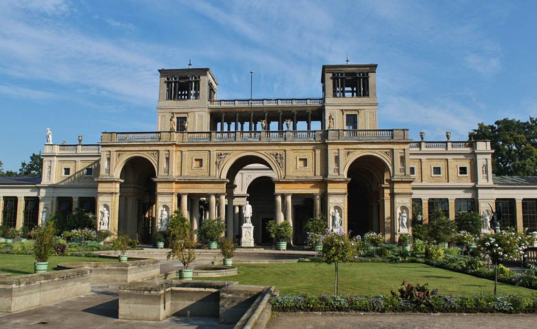 orangery palace in sanssouci park, potsdam germany with its italian renaissance inspired architecture and statue of king frederick william iv in front