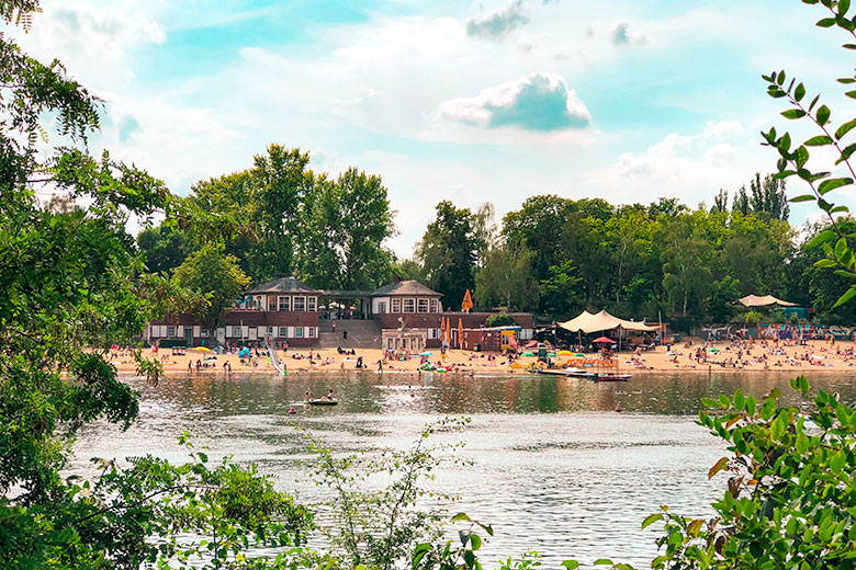 strandbad plotzensee lake in berlin germany with its sandy beaches - a popular outdoor thing to do and has lifeguards, volleyball and stand up paddling