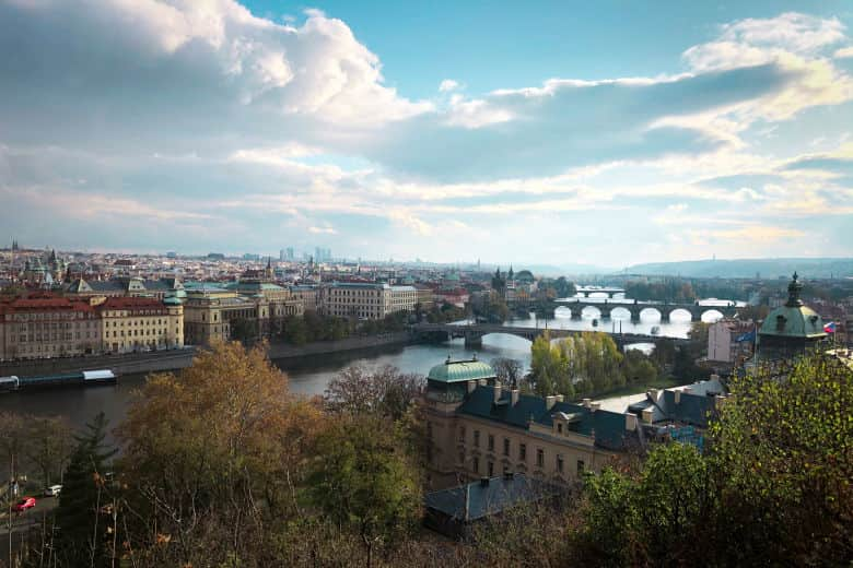 a great photography spot in prague from letna park overlooking the city and the city's many bridges as seen on a free prague walking tour