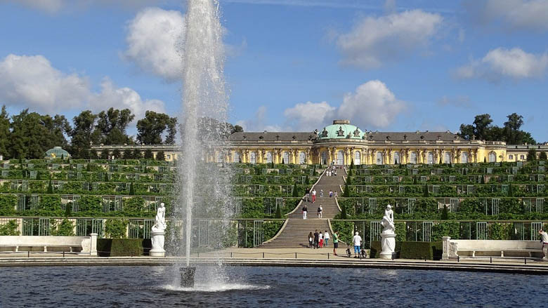 sanssouci palace and its surrounding gardens in the UNESCO world heritage site of sanssouci park is a must see on a day trip from berlin germany