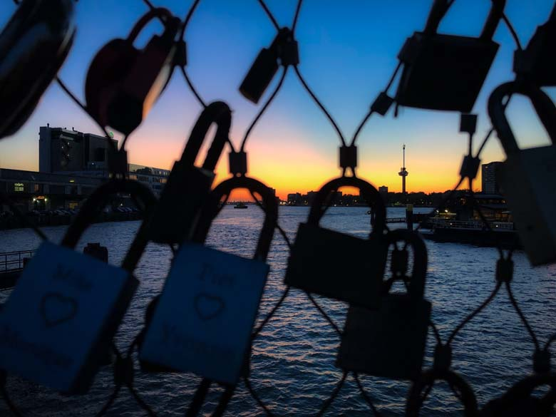best sunset in rotterdam with view of locks on bridge and euromast tower