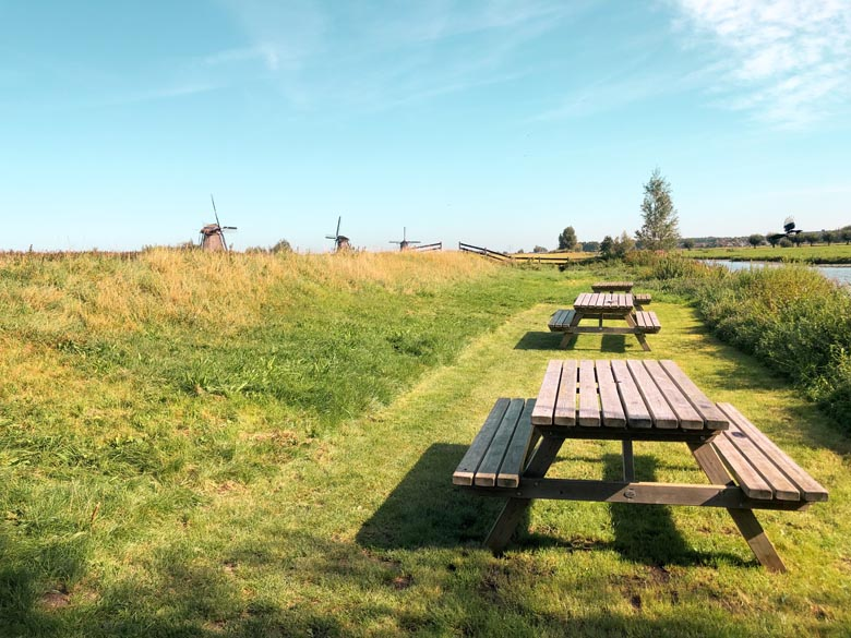 european countryside with picnic benches