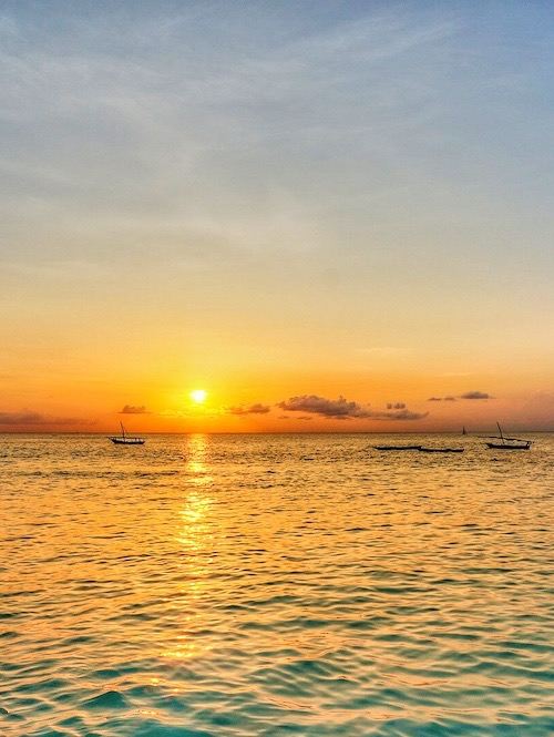 view of the sunset on the best beaches in zanzibar