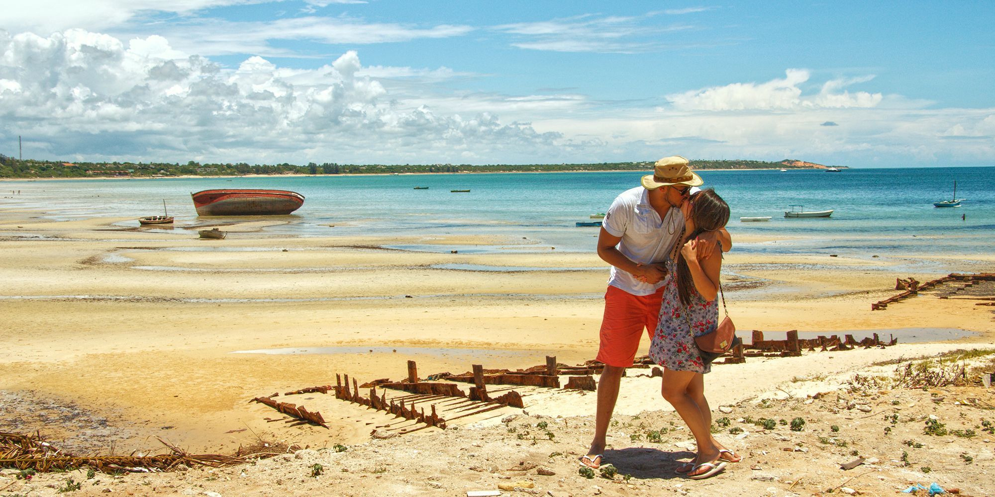 a travel blogger couple kissing on a beach located in the bay of Vilankulos in Mozambique
