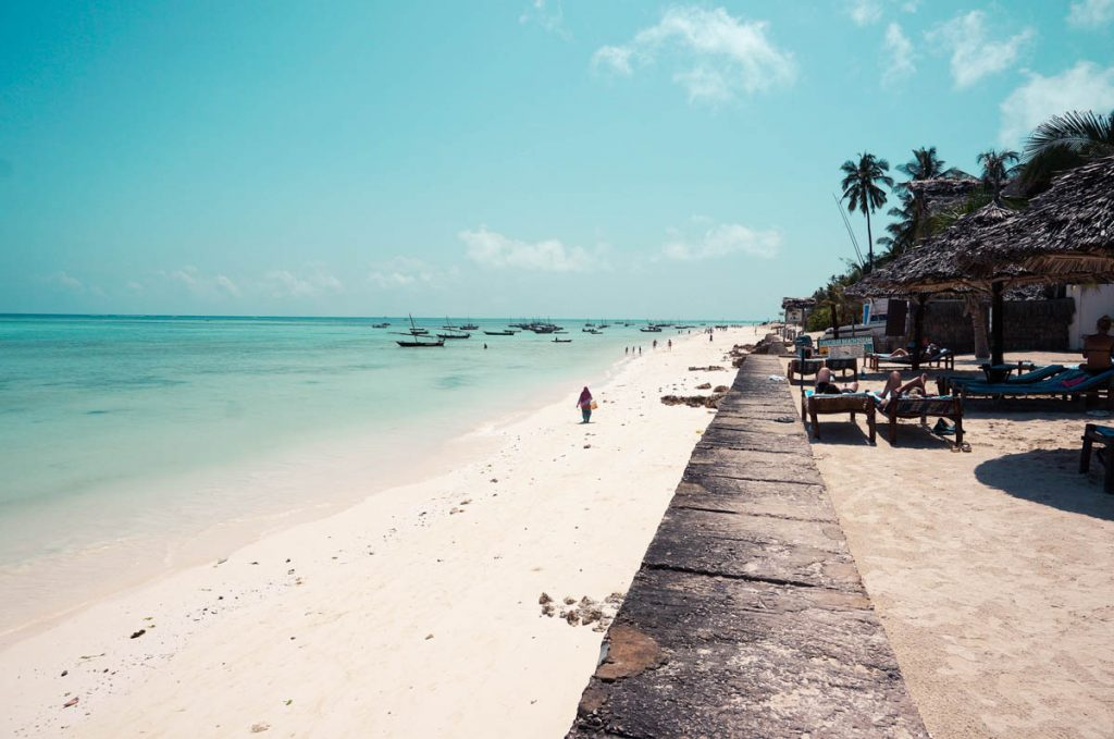 nungwi beach with its turquoise, crystal clear waters and white sand on zanzibar island in front of popular zanzibar hotel doubletree by hilton